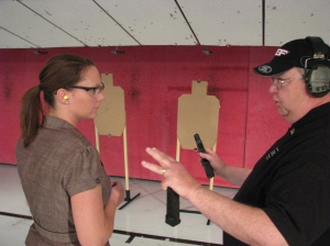 Chris Edwards instructing me how to shoot the G18.